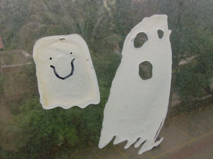 this halloween craft combined two crafts ive done with my kids to make one easy homemade halloween decoration ghost window clings