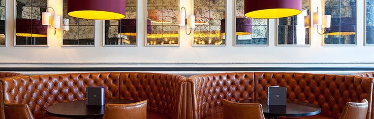 designLSM Renovates Hilton Brighton Metropole Bar - like the pop of yellow inside the shades!