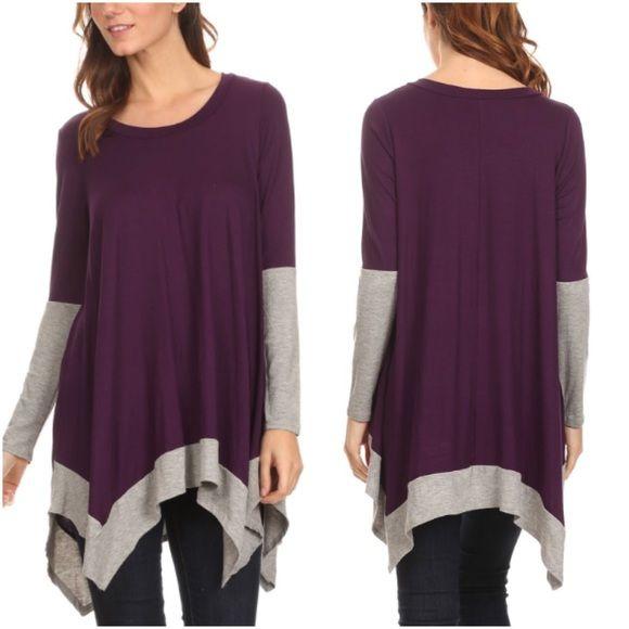 Purple and Grey Tunic Closet fav! Purple color block long sleeve tunic shirt with round neck and asymmetrical hem. Comfy and stretchy. Soft material. Available in S, M and L. Looks great with leggings and boots. Perfume bottle necklace is also for sale in a separate listing. This item is available. Don't forget to check out my Deal of the Month listing ! Hangar 27 Tops Tunics