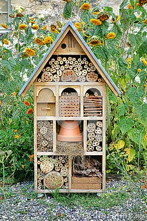 Craftsman Built Insect Hotel Decorative Wood House by Olivier Le Queinec, via Dreamstime