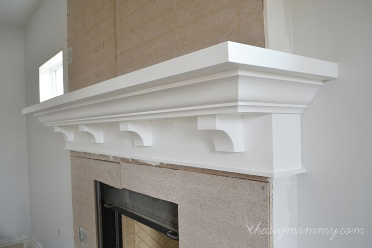 Building Our DIY Fireplace: The Mantel - The DIY Mommy- love diy corbels- maybe a little bigger for mine
