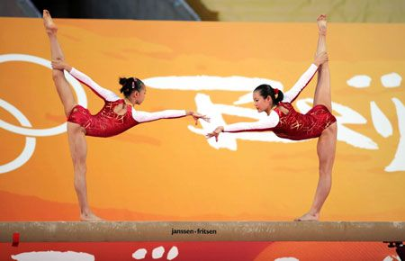 Two of China's Olympic gold medal winners Cheng Fei(R) and Yang Yilin perform during a demonstration in Hong Kong, August 30, 2008