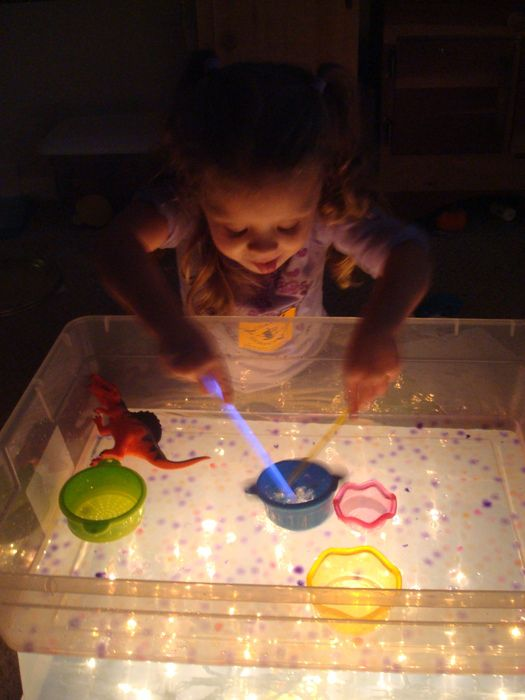 Homemade light table - two plastic bins, turn one upside down with two strings of white lights underneath. Place the other bin on top and play!