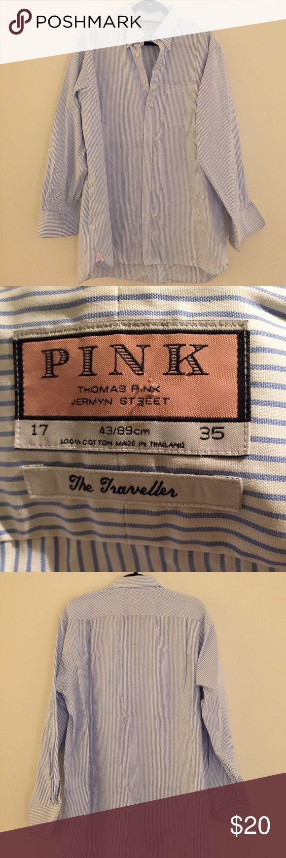 """Thomas Pink Men's shirt (or women's shirtdress!) Blue and white striped men's shirt from Thomas Pink. Men's size 17/35, but I wore it as a shirtdress! Super cute over leggings or tights (and trust me it's long enough, I'm 5'10""""!). Would be great for women's M or L. Chest is 48"""" wide, length from shoulder is 32"""" in the front, 35"""" in the back.  Note one of the buttons has cracked on the cuff but it still works! Otherwise in great condition - no visible tears, marks, stains, etc. From a smoke…"""