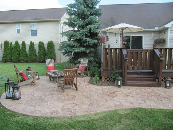 this lower patio area was designed as a kidney shape  the stamped concrete is an added touch to