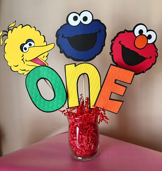 Sesame Street Elmo, Cookie Monster and Big Bird inspired ONE or TWO Table Centerpiece Sticks. Adorable!!! ***Included are 6 sticks for one sided, and 9 sticks for double sided. Glass vase and red paper shred not included! Easily found at the dollar store or craft store. Picture