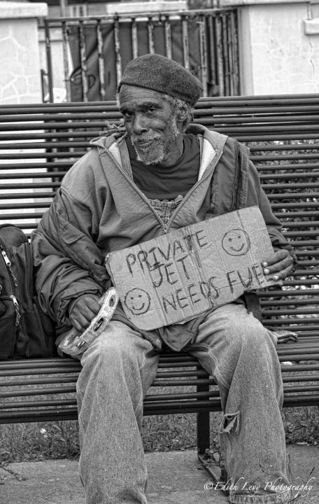 A sense of humor on the streets of New Orleans. Edith Levy - I admire his ingenuity and would give him a couple bucks for it.