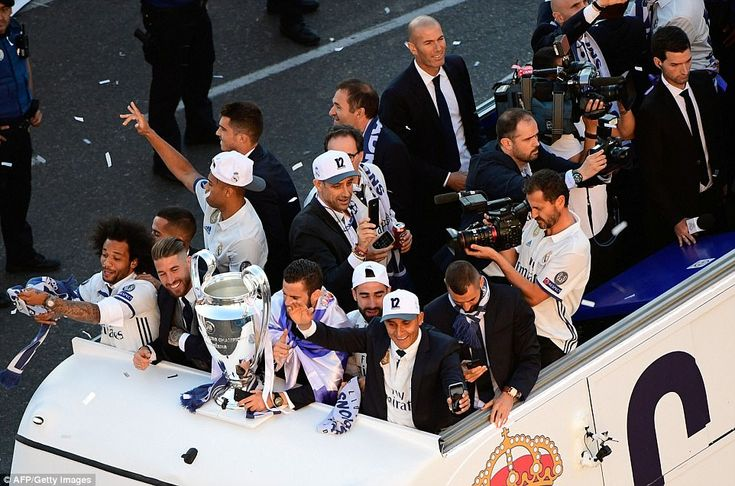 Real Madrid manager Zinedine Zidane (top) smiles as he soaks in the atmosphere on top of t...