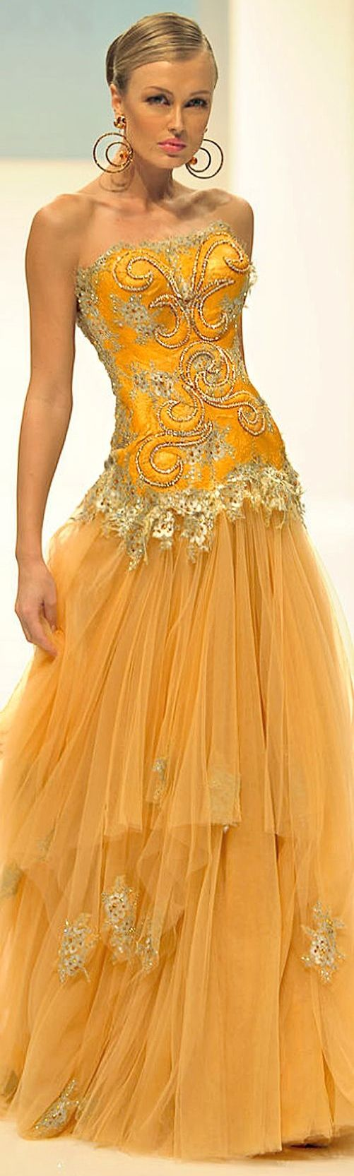 Love the colour and also like how the earrings match the swirls on this yellowy orange gown - Dar Sara S/S 2013