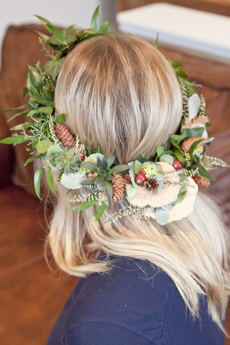 Mama to be wearing a gorgeous floral crown for her modern boho baby shower - woodland theme!