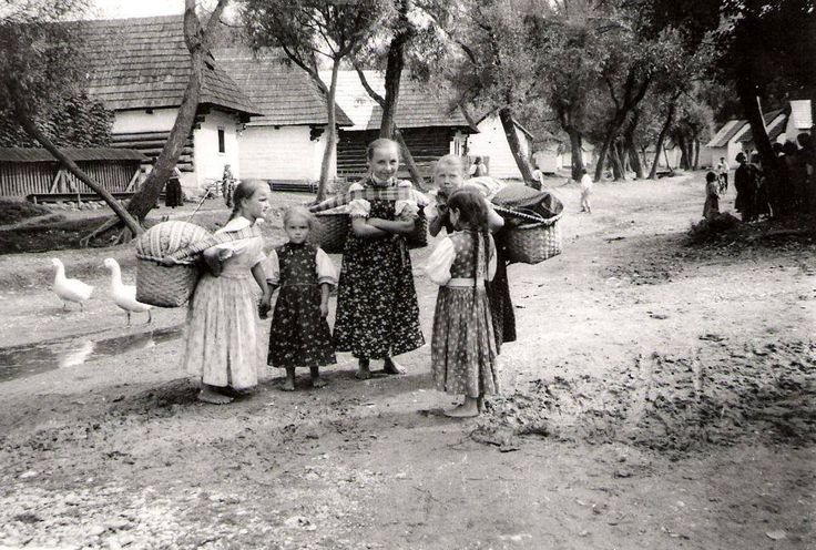 Liptovské Sliače (Liptov) Slovakia around 1936. Pic of my grandma as a little barefoot girl with her siblings and friends. The baskets on girls' backs are for baby-siblings that they were supposed to look after(!)