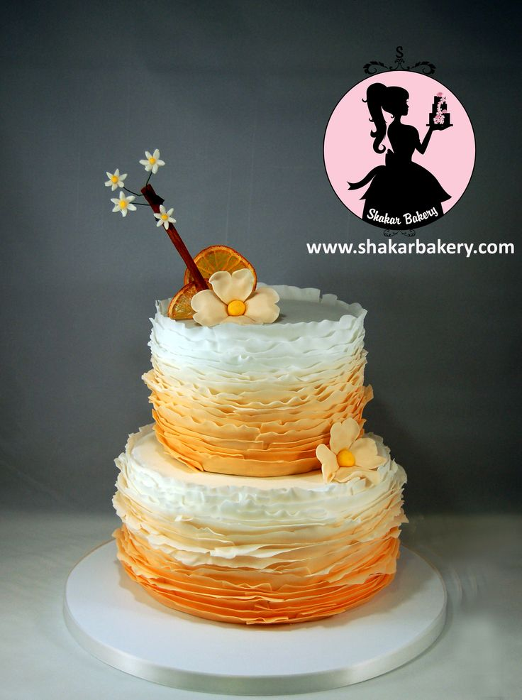 A soft orange ombre ruffle cake. I decided to dehydrate oranges and decorate them on a sprig of fresh cinnamon. I added a few orange blossoms to the cinnamon stick (sculpted out of fondant)  The combination is just too beautiful!!! www.shakarbakery.com www.facebook.com/shakarbakery 818.394.0222