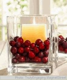 Candle Centerpieces ....pretty idea with cranberry and evergreens for Christmastime too.