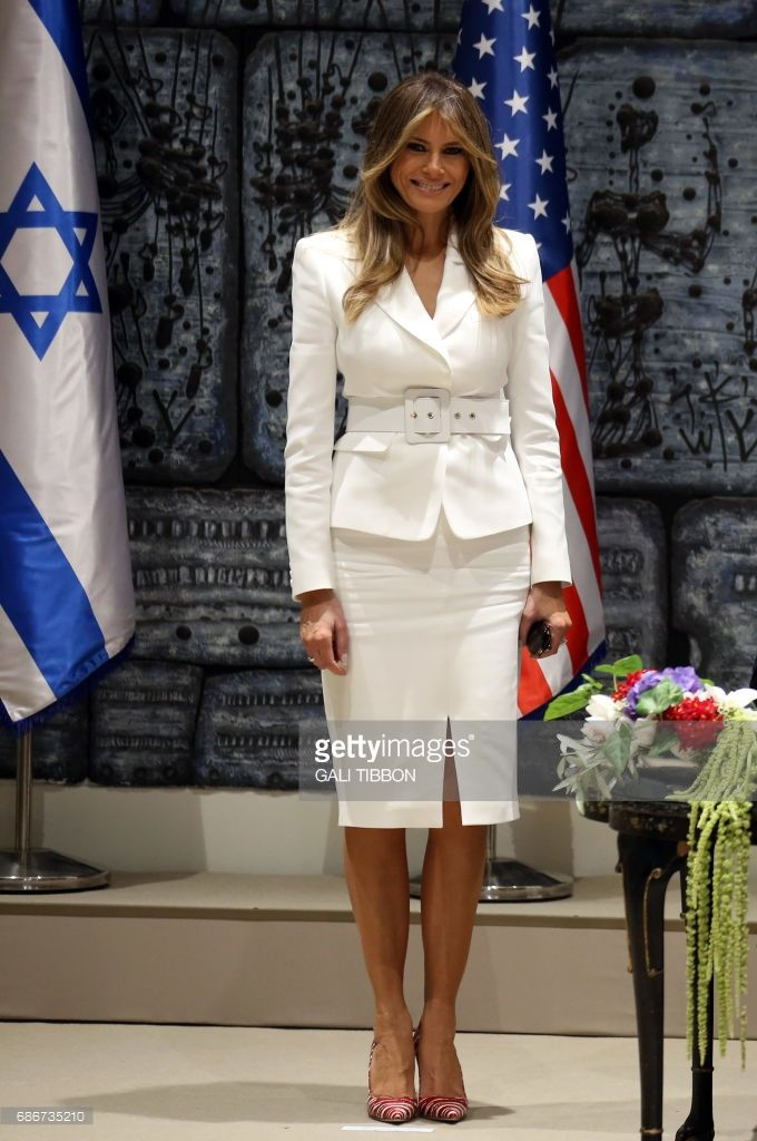 First Lady Melania Trump smiles as she stands next to US President Donald Trump (UNSEEN) as he signs the guest book at the President's Residence in Jerusalem on May 22, 2017. /