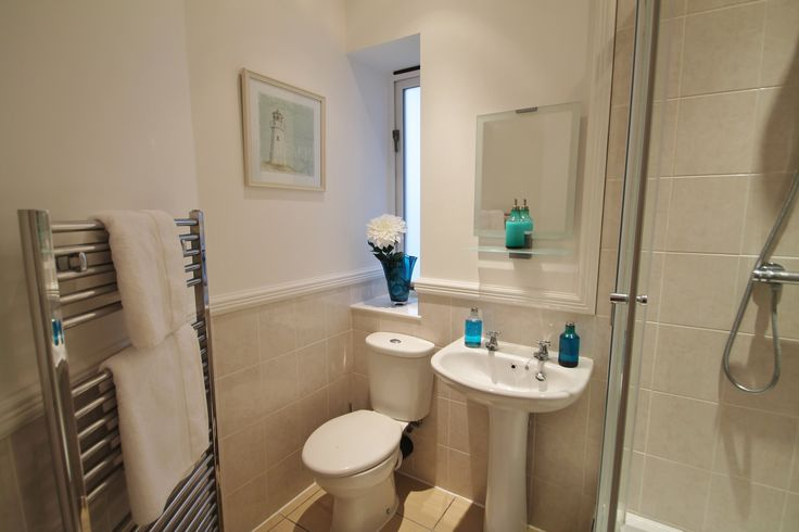 Various decorative accessories were used to stage this bathroom for sale.