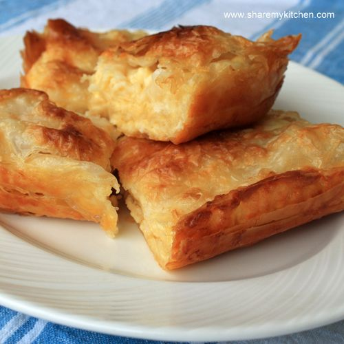 Banitsa (pronounced BAH-nit-sa) is a traditional Bulgarian pastry prepared by layering a mixture of whisked eggs and pieces of sirene (white cheese) between filo pastry and then baking it in an oven._Bulgarian-Recipe_