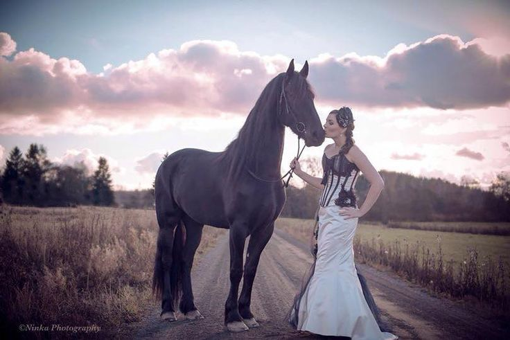 This absolutely gorgeous photo of Johanna Pohjanmies' corset dress was taken by Ninka Photography. What a beautiful horse!