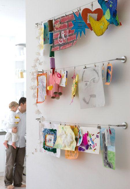 Kids' artwork display using IKEA curtain rails.