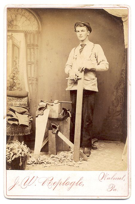 ca. 1890s-1900s, [cabinet card portrait of a handsome young carpenter posed with the tools of his trade], J. W. Replogle  via Capitol Gallery, Cabinet Cards