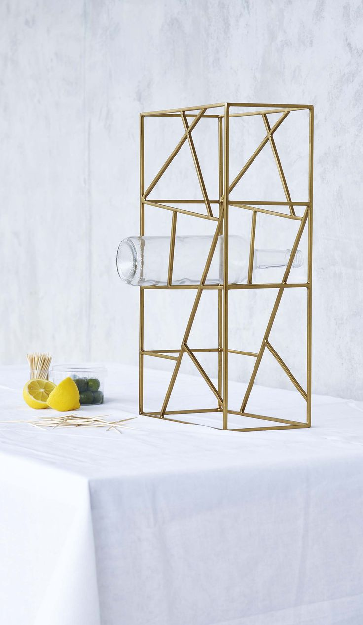 Entertaining is given a metallic edge with the Grid Wine Rack in gold.