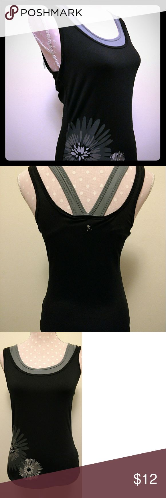 """Danskin Now Yoga Top Gray Black Medium Danskin Now ladies yoga top. 2 layers features a built in bra that is un-padded. Bra layer is gray and the outside main body is black with gray flower on the front. In excellent pre-owned condition  Across the chest is 15.5"""" un-stretched and from the shoulder to the hemline is 23"""". Danskin Now Tops Tank Tops"""