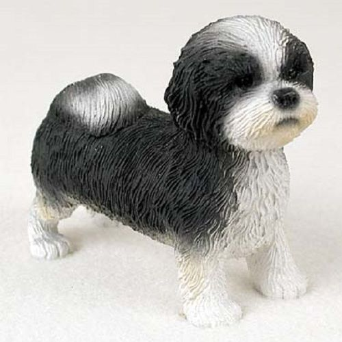 Shop for black and white Shih Tzu dog with sport cut figurine. It makes a fine gift or collectible for pet and home decor. Each dog breed figurine is hand painted, museum quality and stone resin.