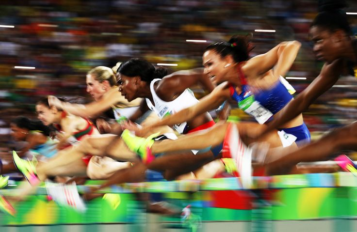 Tiffany Porter of Great Britain (center) competes in the Women's 100m Hurdles…