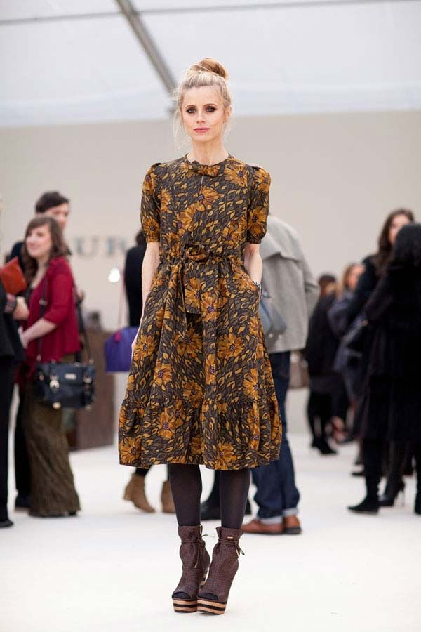 A vintage inspired dress is toughened up with platforms by Burberry.    #streetstyle #londonfashionweek