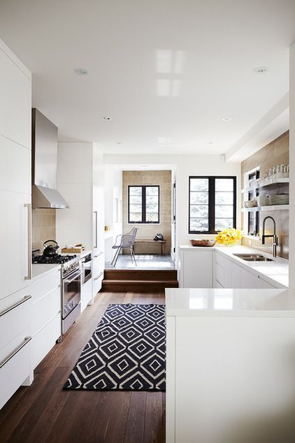Transitional Kitchen by Barbara Purdy Design Inc.A chic rug. If you've shied away from using a rug in the kitchen for fear of spills and stains, try a chic indoor-outdoor version. These rugs come in beautiful colors and patterns now, and no one has to know about the stain-fighting powers.