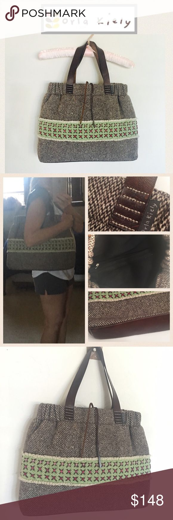"""Orla Kiely Wool Bag Grab this quick! Are you a collector or lover of unique and rare bags? This spacious designer bag is done in a gray tweed wool with green pattern, leather handles, closure tie and leather bottom. Clean black interior with zip pocket. Measures approx 17"""" x 13"""" EUC  Orla Kiely Bags"""