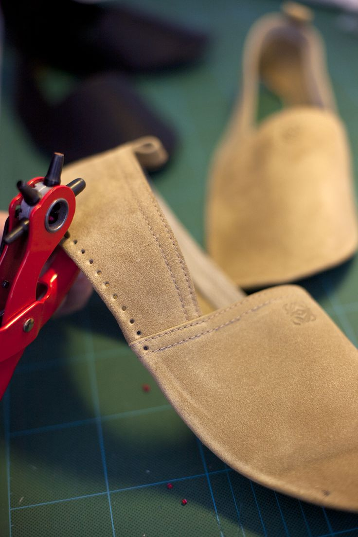 The final step is to pierce the leather part before sewing it to the rope sole. It takes more than two hours, stitch by stitch, for each pair of espadrilles.