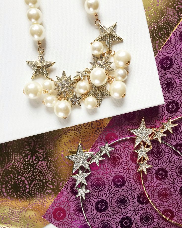 Star necklaces in gold, silver, and pearl from t+j Designs.