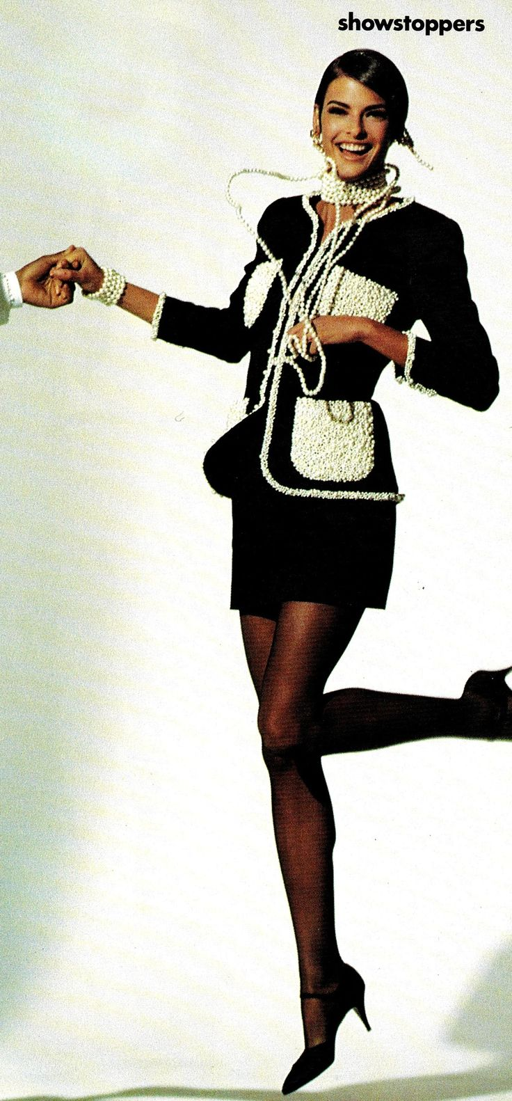 vintagebinger:  Linda Evangelista was undeniably the face of the 90s. Here she is in a black Chanel suit with pearl-encrusted pockets and trim. Coco would have been proud. Photo from Vogue, March 1990.