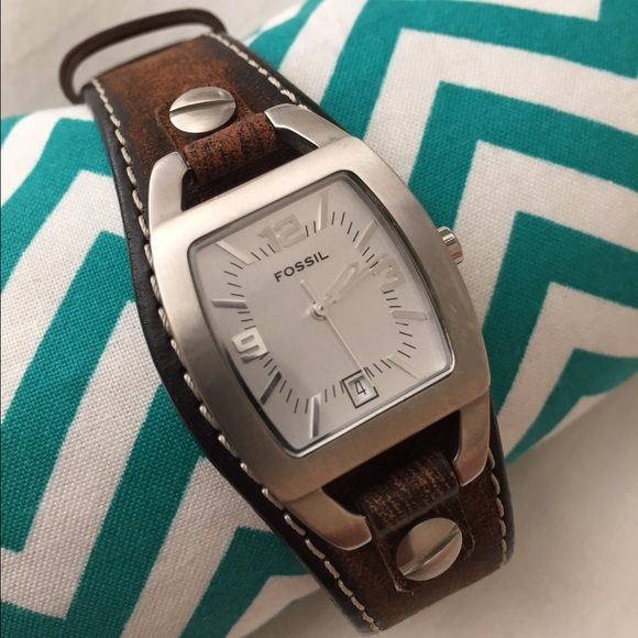 Ladies Fossil Watch This watch is a must-have! Ladies leather Fossil watch. Has been worn a few times but is in excellent condition. I just had the battery replaced so it is working perfectly. Looks great in any season! Fossil Accessories Watches