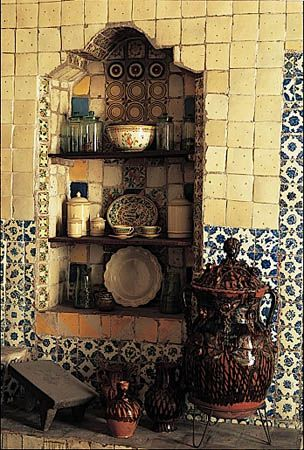Might be fun to do a small section of a wall as a feature wall with a built in and colorful vintage painted tiles