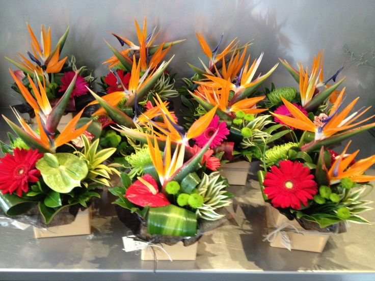 Tropical table flower arrangements for a function at Bond Uni.