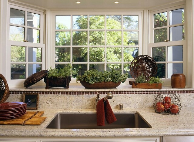 Bay window over the kitchen sink for Small kitchen window ideas