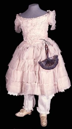 c. 1856;  Pink taffeta child's dress covered with coarse stiff pink muslin, with short sleeves and low neck.