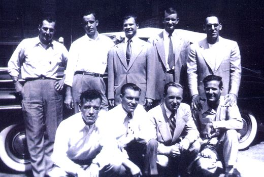 Taken several years after WWII, this photo shows the following, standing l. to r.:Amos 'Buck'Taylor, Darrel 'Shifty'Powers, Herb'Junior' Suerth, Robert Rader, and Ed Tipper. Below l. to r.: Floyd 'Tab' Talbert, Wally Wentzel, Don Moone, and Walter 'Smokey' Gordon.  Photo courtesy of Bob Talbert, 11th Airborne Division.