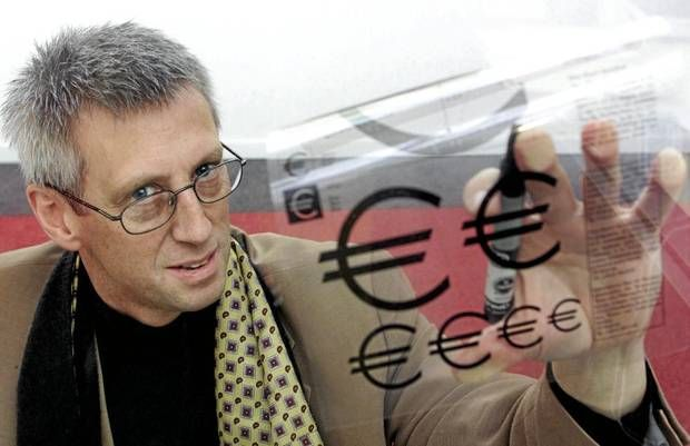 Belgian graphist Alain Billiet, who designed the euro sign before the launch of the single currency in 1999, displays his creation in Brusse...