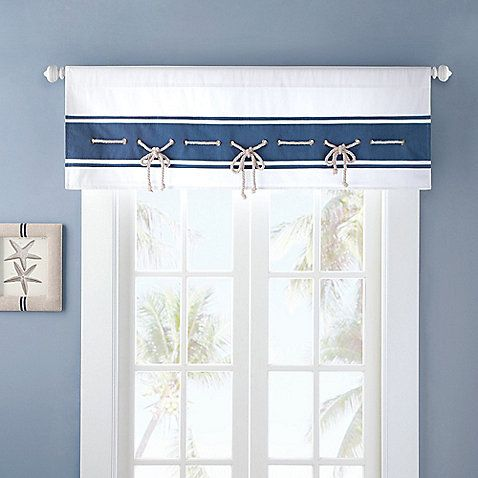 Give any room a nautical look with the Harbor House™ Sailor Window Valance. Adorned with a sailing rope trim and mini grommet detail on a blue and white background, the lined valance is the perfect finishing touch to your seaside decor.