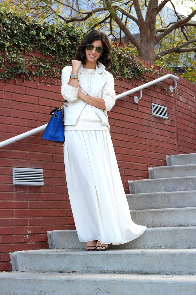Though I may not rock out a white maxi skirt, I definitely love the idea of pairing a  white/ivory vest over a white/ivory sweater.. maybe with white jeans. *squeal* I love Winter Whites!