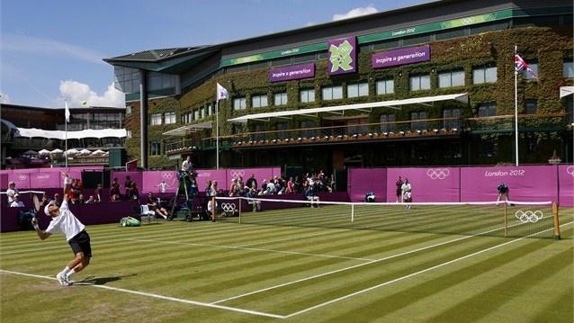 Nikolay Davydenko of Russia serves at Wimbledon