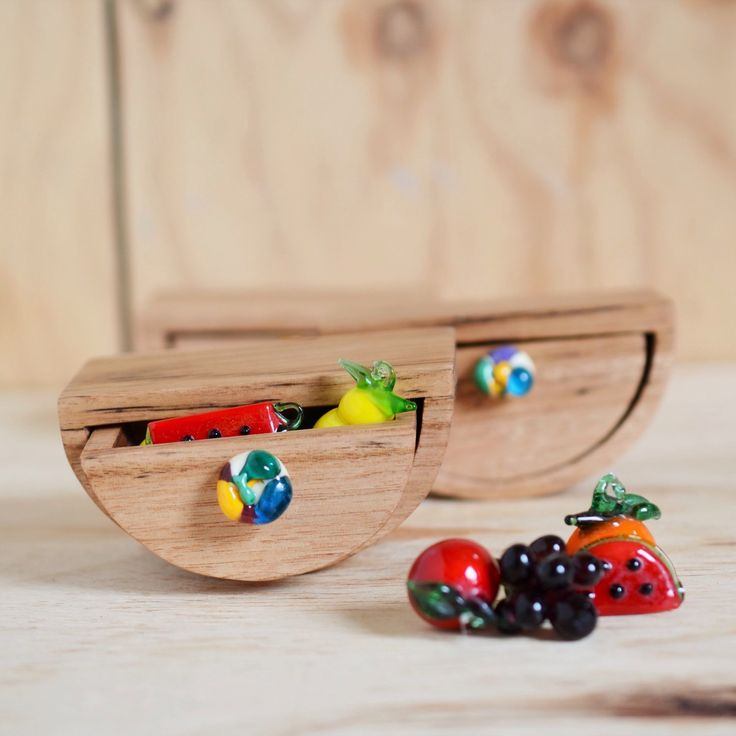 Rocking boxes made from reclaimed eucalypt timber with colourful glass drawer pulls