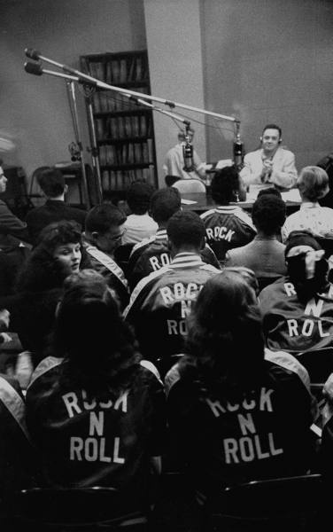 Teens, 1955    Teenagers listen to a radio show in the studio. DJ Alan Freed, also known as Moondog  became internationally known for promoting the mix of blues, country and rhythym and blues music on the radio in the United States and Europe under the name of rock and roll.