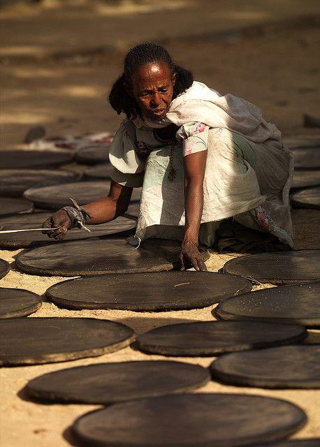 Woman making injera (yeast-risen flatbread), at the Keren market in Eritrea. Photograph: Eric Lafforgue.