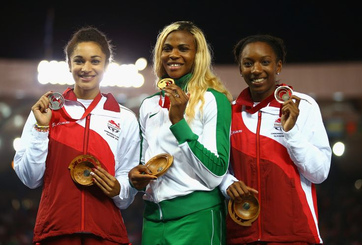 (L-R) Silver medallist Jodie Williams of England, gold medallist Blessing Okagbare of Nigeria and bronze medallist Bianca Williams of England