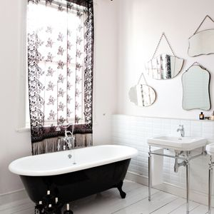 Beautiful bathroom with vintage mirrors