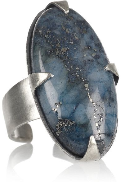Silver Lapis lazuli cabochon Adjustable band, designer-stamped interior This piece is made from natural materials and as such may have some irregularities