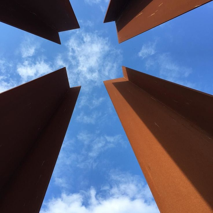 Looking up through Corten Steel columns that  create the volume where a border guard tower would have stood at the Berlin Wall. Brilliant modern monument and the picture does it little justice. #berlin #berlinwall #modern #modernarchitecture